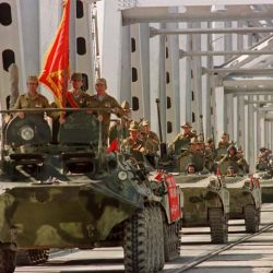 TERMEZ, RUSSIA - MAY 21:  A convoy of Soviet Army armoured personal vehicles cross a bridge in Termez, 21 May 1988 at Soviet-Afghan border, during the withdrawal of the Red Army from Afghanistan. The Soviet Union invaded Afghanistan in December 1979 to shore up the pro-Soviet regime in Kabul and maintained more than 100,000 troops in the country until completing their phased withdrawal in 1989.  (Photo credit should read VITALY ARMAND/AFP/Getty Images)